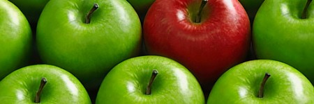 Red apple in basket of green apples